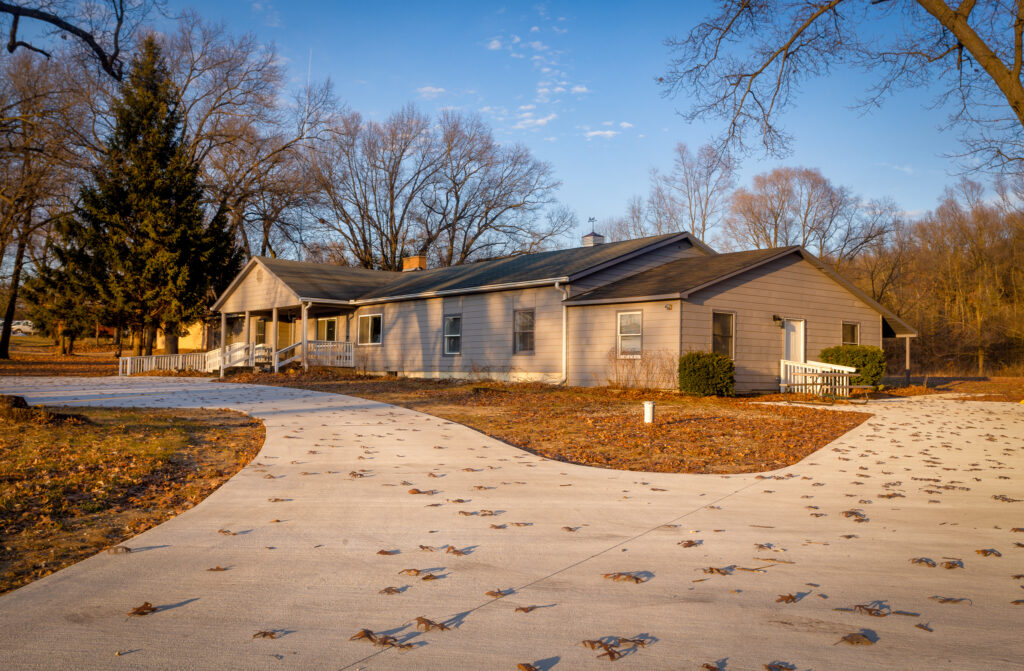A picture of the adult foster care home on Northland Dr. in Rockford. A picture of the driveway with a house sitting at the end of it.