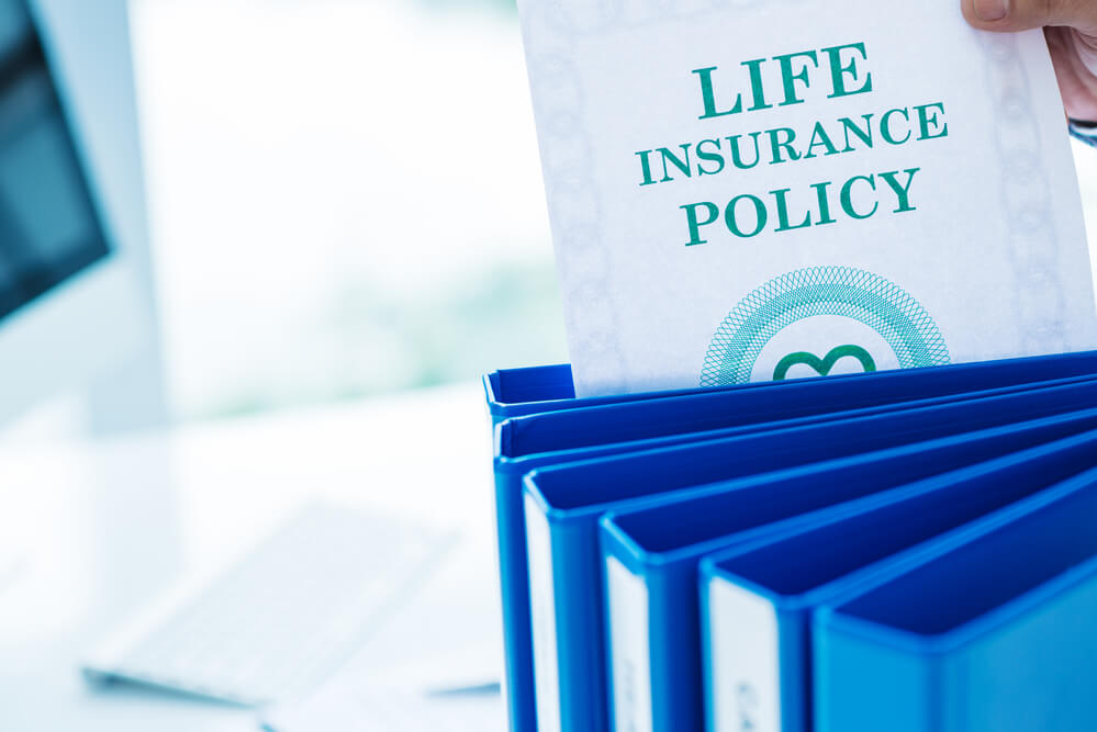 A picture of a paper that has the word life insurance on it. Picture to add to the paragraph regarding selling life insurance to fund adult foster care.